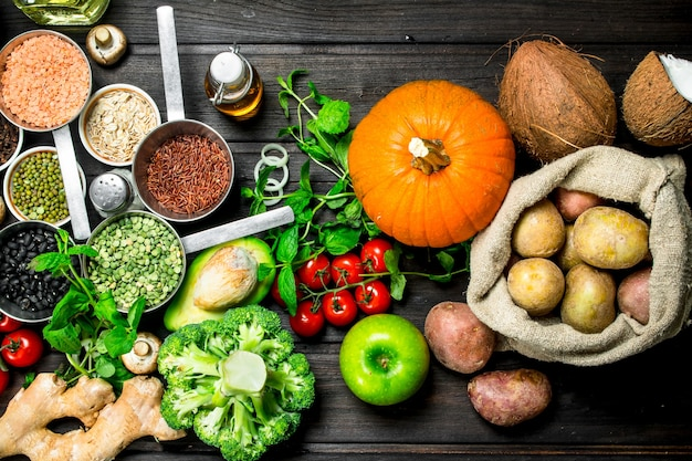 Organic food. healthy assortment of vegetables and fruits with legumes on wooden table.