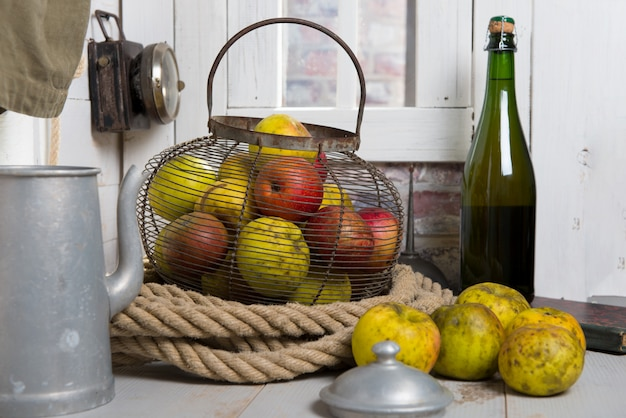 Organic fresh apples with bottle of normandy cider