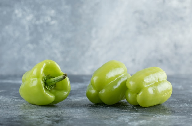 Organic fresh green pepper on grey background. high quality photo
