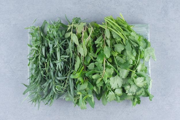 Organic fresh greens on grey background.