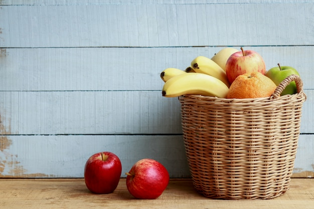 Organic fruit in basket with colorful wall