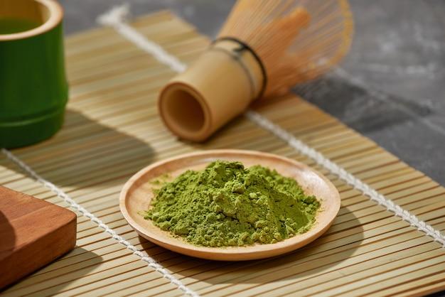 Organic green matcha tea on wooden table, copyspace