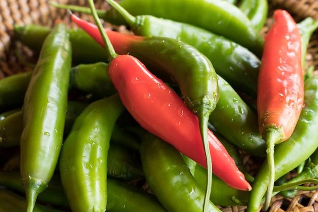 Organic green and red aji cristal pepper or chilli pepper (capsicum baccatum)