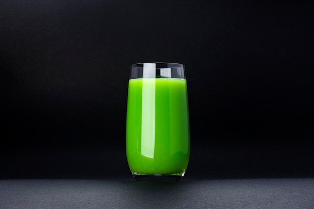 Organic green smoothie, apple juice on isolated on black background with copy space, fresh cocktail