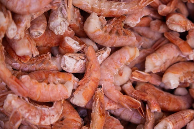 Organic grown shrimps chilled in ice, top view. abstract background and food texture.