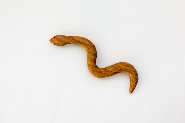Organic hand made wooden snake toy isolated on white