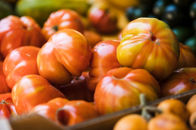 Organic heirloom tomatoes in display at a market