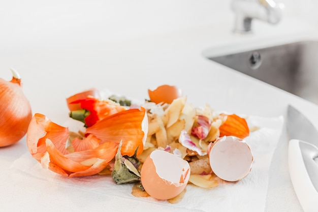 Organic home cooking food waste ready to compost. ecological concept. food leftovers, vegetable peelings on kitchen table. environmentally responsible behavior, waste management, recycling garbage.