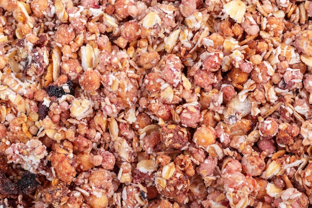 Organic homemade granola cereal with oats and almond. texture oatmeal granola or muesli as background.