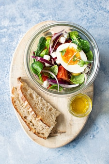 Organic homemade salad in a glass bowl