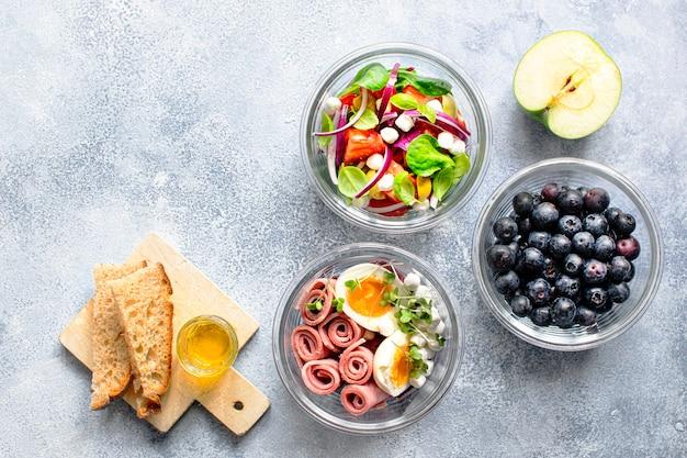 Organic homemade salad in glass bowls