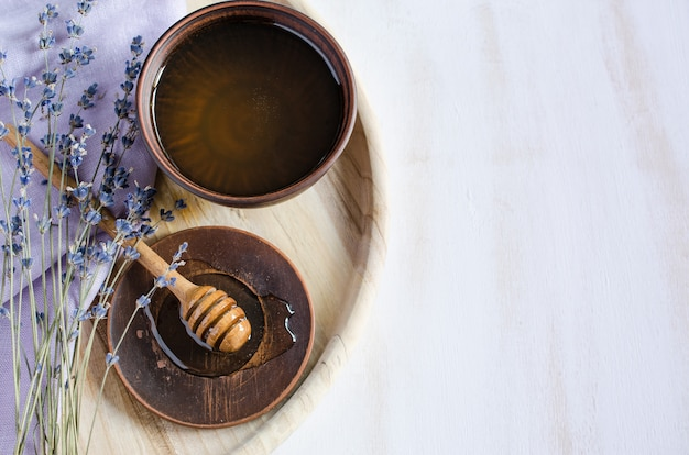 Organic honey and lavender on wooden table.