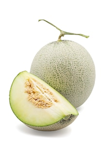 Organic japanese honeydew melon and a half on white isolated background with clipping path.