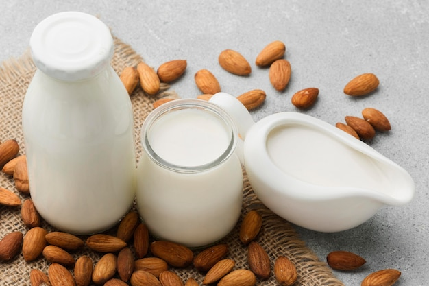 Organic milk with delicious almonds on the table