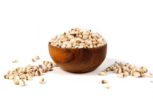 Organic millet grains on wood bowl