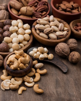 Organic nuts snack in bowls high view