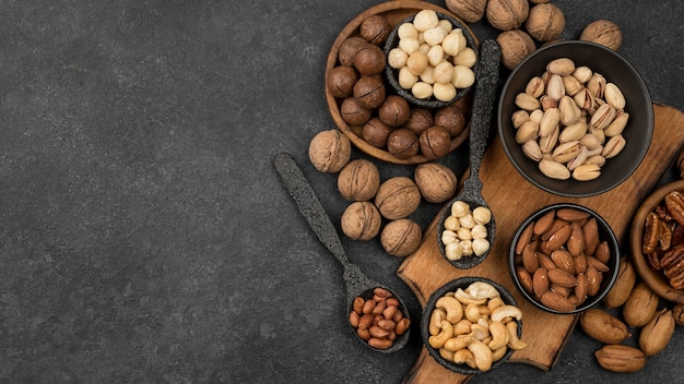 Organic nuts snack in bowls and spoons