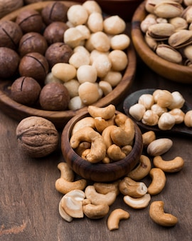 Organic nuts snack in bowls on wooden table