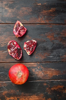 Organic pomegranate over old dark wooden table