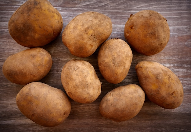 Organic potatoes on wooden board