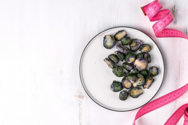 Organic purple brussel sprouts fried on plate