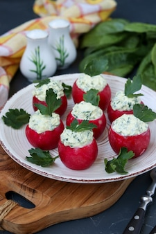 Organic radish stuffed with feta cheese, spinach and boiled egg