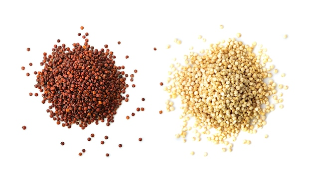 Organic red and white quinoa seeds on a white background