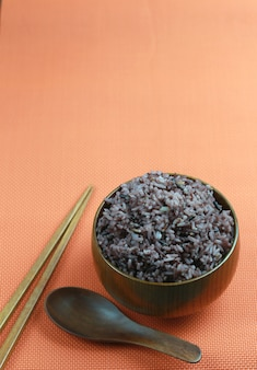 Organic rice berry in wooden dish.