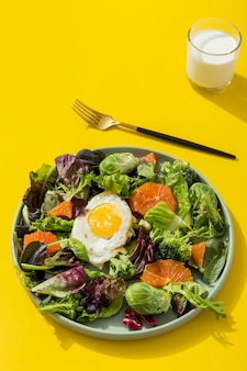 Organic salad with egg on the table