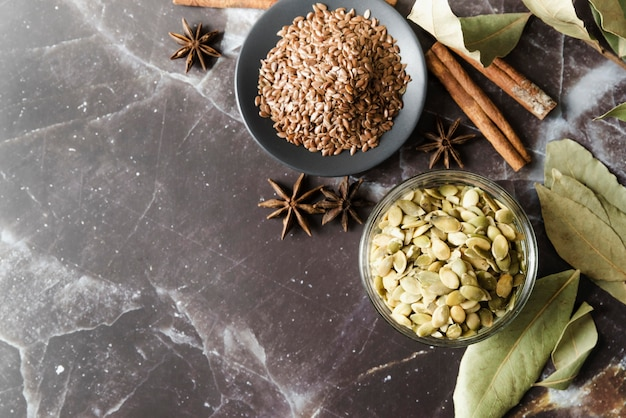 Organic seeds and dried star anise flowers