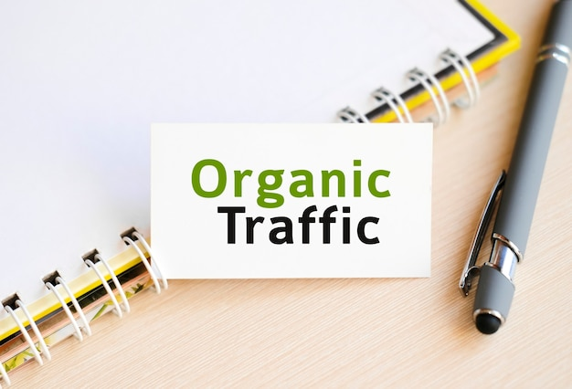 Organic seo traffic - text on a notebook with a spring and a gray handle