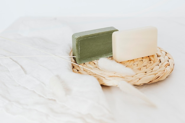 Organic soap bars with grass flowers in spa setting