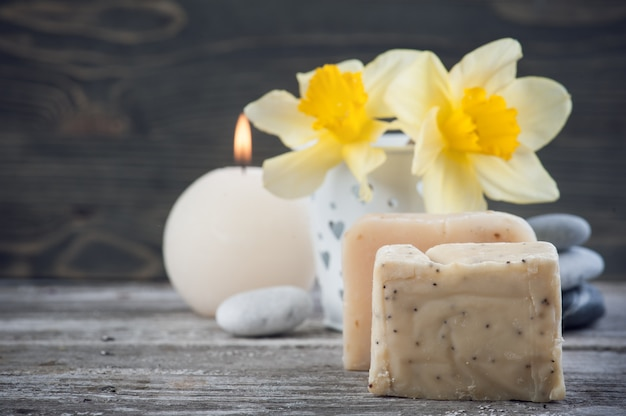 Organic soap and yellow flowers