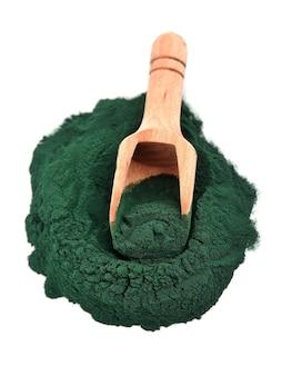 Organic spirulina algae powder in a wooden spoon isolated on white.