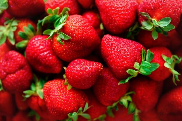 Organic strawberries background. vegan and vegetarian concept. berries texture. summer healthy food.