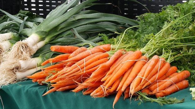 Organic vegetables on counter fresh local produce homegrown on stall farmers food market in usa