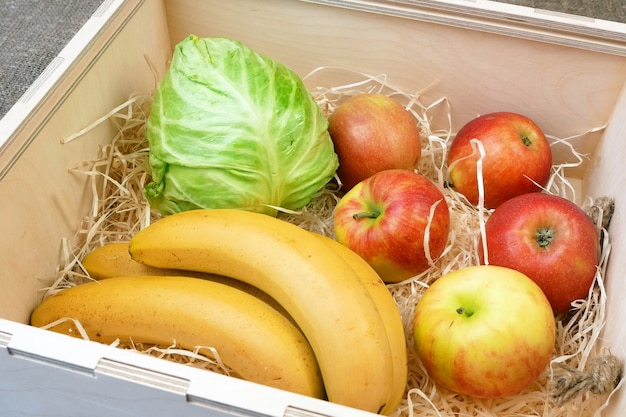 Organic vegetables and fruits in wooden box