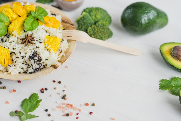 Organic vegetables and tasty food on white wooden plank