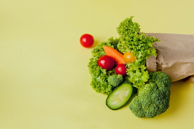 Organic vegetables on yellow background.