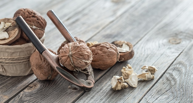 Organic walnut lies on a wooden background , close-up .