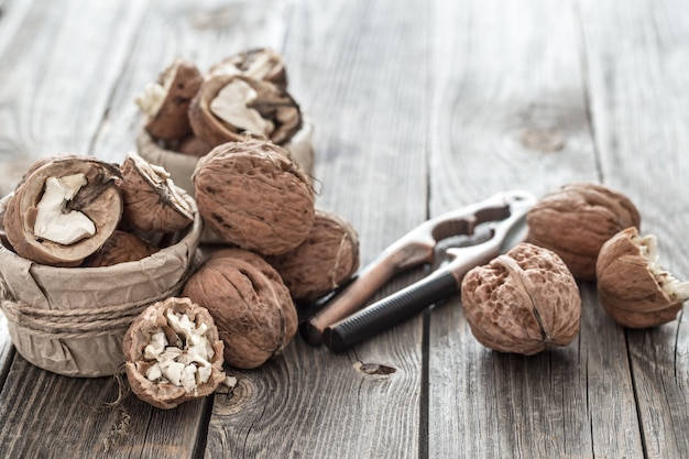 Organic walnut lies on a wooden wall , close-up .