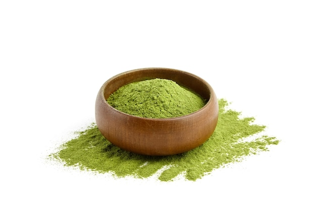 Premium Photo   Organic wheatgrass seeds for sprouting in wooden spoon on  weatgrass powder background. top view
