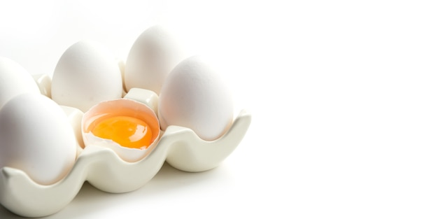 Organic white chicken eggs in porcelain decorative box. close up with copy space.