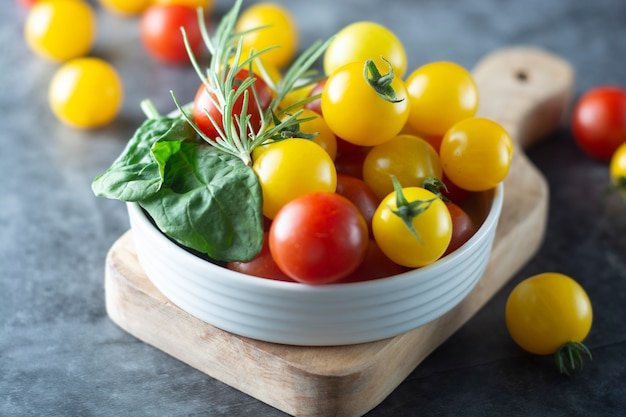 Organic yellow and red tomatoes in plate
