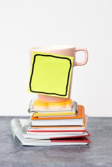 Organized stack note pad, bundle notebooks, neat pile documents, pleasant arrangement writing materials, clean workspace, office academic business collections