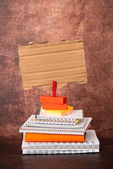 Organized stack note pad, bundle notebooks, neat pile documents, pleasant arrangement writing