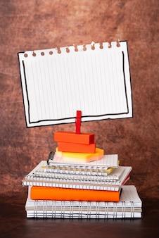 Organized stack note pad, bundle notebooks, neat pile documents, pleasant arrangement