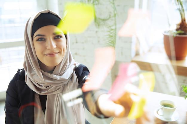 Organizing tasks portrait of a beautiful arabian businesswoman wearing hijab