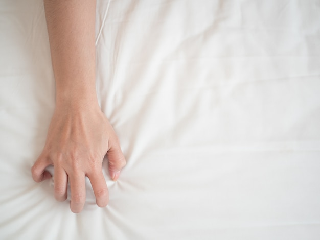 Orgasm hand of woman in  lust and love
