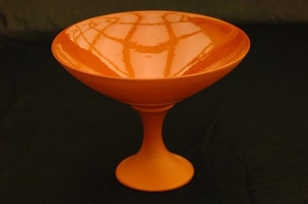 Oriental antique ceramic bowl on a black background closeup